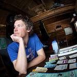 Nathaniel Contemplates His Next Move in Monopoly at Windy Gap Cabin by Joe Connolly